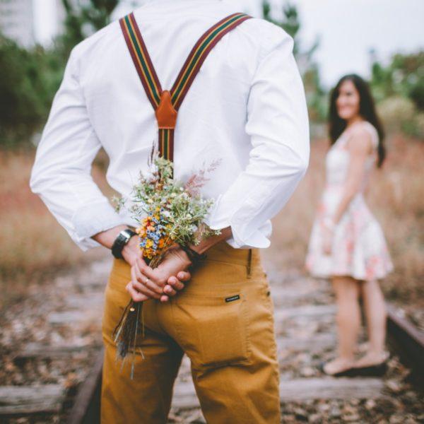 adult-blur-bouquet-boy